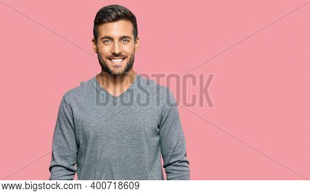 Handsome hispanic man wearing casual clothes with a happy and cool smile on face. lucky person.