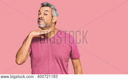 Middle age grey-haired man wearing casual clothes cutting throat with hand as knife, threaten aggression with furious violence