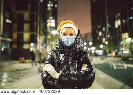 White Medical Gloves Dress On Hands Adult Woman On Street City Europe During The Lockdown Quarantine