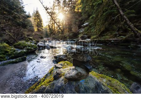 Stack Of Rocks By The Beautiful River In Canadian Nature During Winter. Taken In Brandywine Falls, N