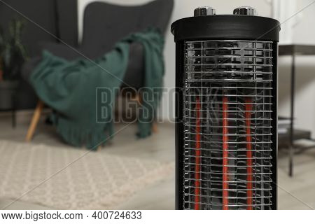 Modern Electric Halogen Heater In Room, Closeup. Space For Text