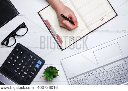 Concept Of Planning And Successful Business Management. The Human Hand Writes Down Plans For Current