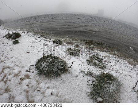 View of the winter Dnepr river in Kiev at snowstorm