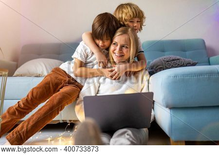 Mother trying to work from home with her kids as a company