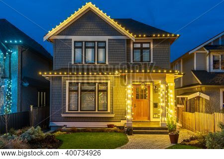 House Decorated and Lighted for Christmas and New Year at Night at Vancouver, Canada.