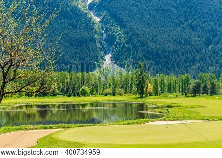 Golf course with gorgeous green and fantastic montain view.
