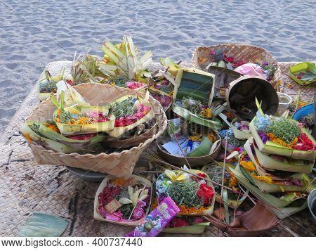 Badung Bali, Indonesia - October 12, 2019: A Few Piles Of Balinese Offerings Canang Sari On Petiteng
