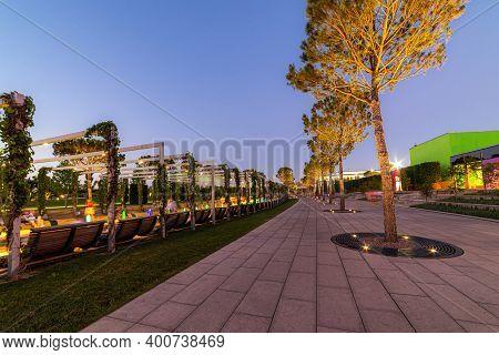 Maple Alley In French Garden In Public Landscape City Park Krasnodar Or Galitsky Park . Wooden Circu