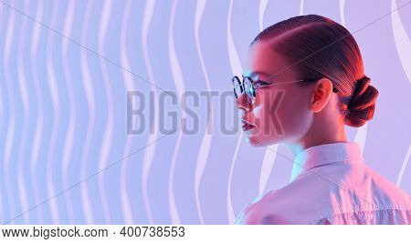 Portrait of a beautiful young woman in elegant glasses on a background with copy space. Glasses fashion. Business style.