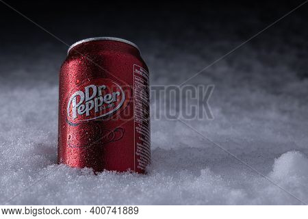 Cold Can Dr Pepper With Water Drops In The Snow In Winter. Dr Pepper Is A Soft Drink Marketed As Hav