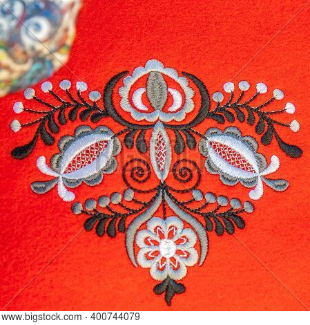 Background With Detail Of Traditional Hungarian Folk Embroidery Handmade On Textile Support.