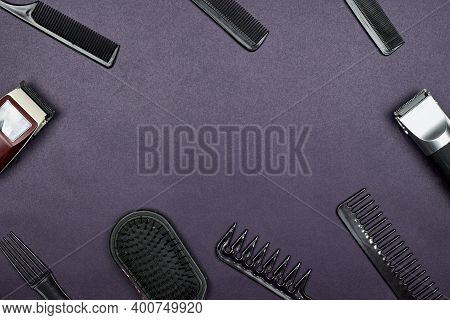 Barber Accessories On Dark Background With Copy Space In The Center. Hair Dresser Tools Arranged On