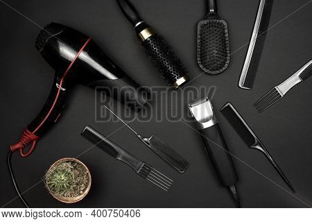 Barber Accessories On Dark Background. Hair Dresser Tools Arranged On Dark Background. Tools Of Barb