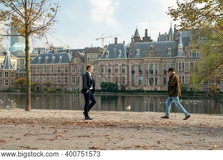 The Hague, The Netherlands - November 10, 2020: Two Men Pass Each Other At A Distance Of 1.5 Meters.