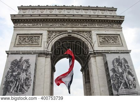The National Flag Of France In The Arch Of The Arc De Triomphe In Paris. Architecture Arch With The