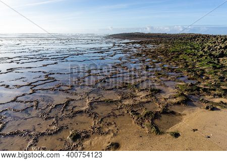 Rocky And Sandy Beach On The Alentejo Coast On Portugal At Milfontes