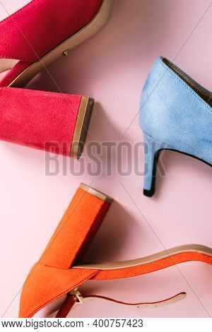 Multi-colored Womens Shoes With Heels On Pink Background. High Quality Photo