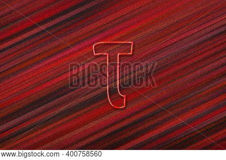 Tau Sign. Tau Letter, Greek Alphabet Symbol, Red Background