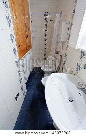 Interior Of Narrow Toilet Room