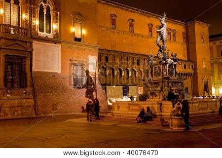 Fountain of Neptune on Piazza del Nettuno with shade on Sala Borsa in Bologna at night Italy poster