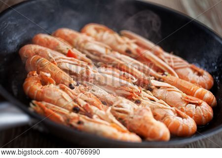 Roasted Scampi With Lemon, Garlic And Herbs On A Pan.