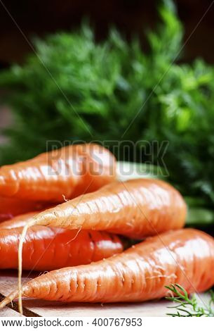Fresh Spring Carrot On A Vintage Wooden Background, Rustic Style, Selective Focus