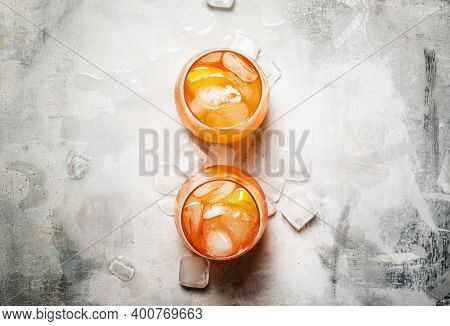 Italian Summer Cocktail With Aperitif Named Aperol Spritz With Bitter, Ice, Sparkling Wine And Orang