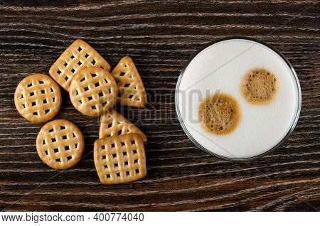Few Cookies Triangular, Square And Round Shape, Glass With Latte-macchiato On Dark Wooden Table. Top