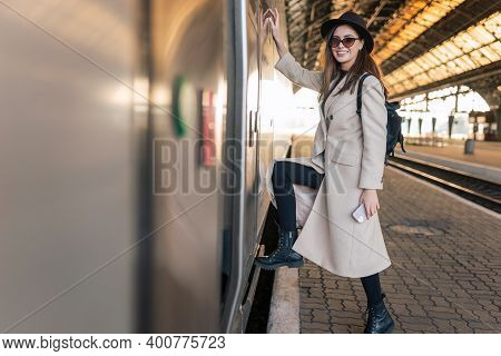 Girl Enters To The Train Car. Traveler At The Train Station