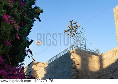 Bethlehem, Israel, December 09, 2020 : Large Cross And Flags On The Roof Of The Church Of Nativity B