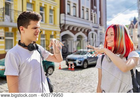 Teenage Boy And Girl Meeting, Greeting With Hands, Street Sunny Summer City Background. Lifestyle, Y