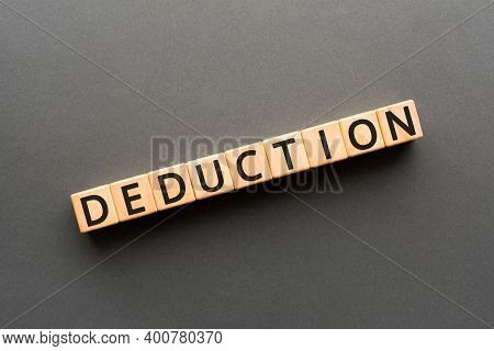Deduction - Word From Wooden Blocks With Letters, The Process Of Reaching A Decision Or Answer Deduc