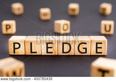 Pledge - Word From Wooden Blocks With Letters, Deposit, Guarantee, Bail, Promise, Pledge Concept, Ra