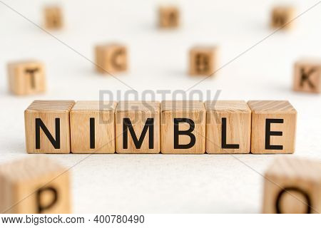 Nimble - Word From Wooden Blocks With Letters, Quick Agile Nimble Concept, Random Letters Around Whi