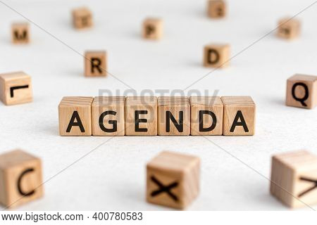 Agenda - Words From Wooden Blocks With Letters, A List Of Matters Agenda Concept, White Background