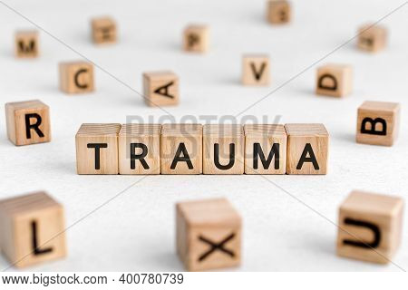 Trauma - Words From Wooden Blocks With Letters, Physical Or Mental Injury Trauma Concept, White Back