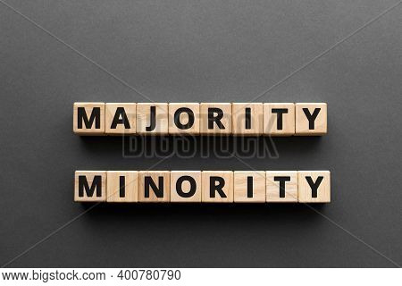 Majority Minority - Words From Wooden Blocks With Letters, Majority Minority Concept, Top View Gray