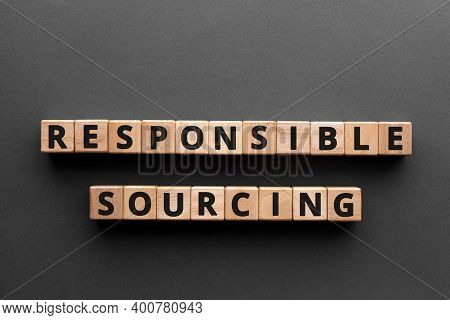 Responsible Sourcing - Word From Wooden Blocks With Letters, Responsible Sourcing Concept, Gray Back