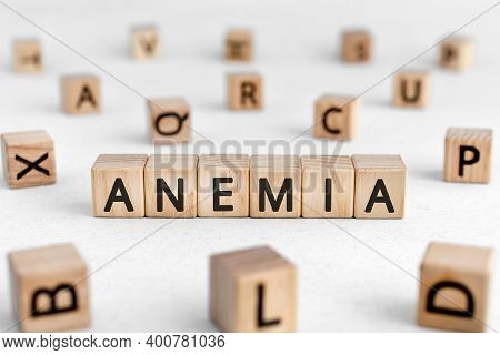 Anemia - Words From Wooden Blocks With Letters, A Low Number Of Red Blood Cells Anemia Concept, Whit