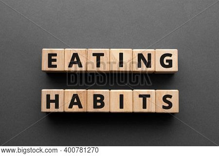 Eating Habits - Words From Wooden Blocks With Letters, Healthy Eating Habits Concept, Top View Gray