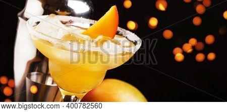 Mango Daiquiri, Alcoholic Cocktail With White Rum, Liqueur, Syrup, Lemon Juice, Mango And Ice On Bla