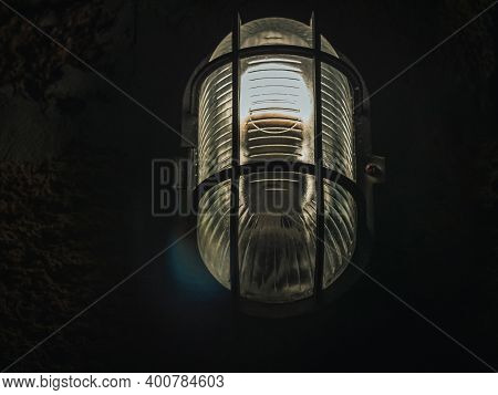 Outdoor Lamp Light Glowing In The Dark. Beautiful Dusty Lantern Hang In Front Of House In The Night.