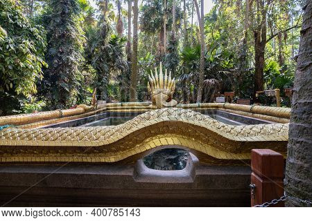 Udon Thani, Thailand-december 22, 2020: A Beautiful Serpent Sculpture And Is A Respected Place Among