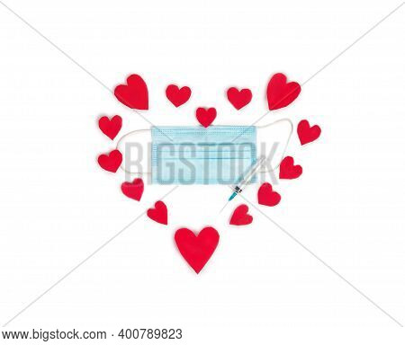 Blue Protective Medical Mask With Syringe For Vaccine Covid-19 2021, Surrounded With Red Hearts Isol