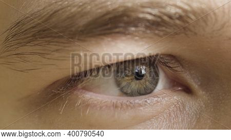 Close Up Of Human Eye Expressing Concentration On The Object. Action. Male Eye Under Sunlight Lookin