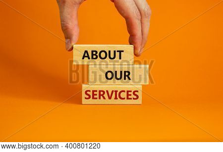 About Our Services Symbol. Wooden Blocks Tower With Words 'about Our Services'. Male Hand. Beautiful