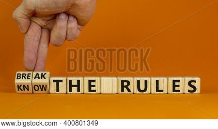 Know And Break The Rules Symbol. Hand Turns Cubes And Changes Words 'know The Rules' To 'break The T