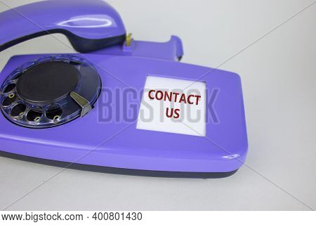 Contact Us Symbol. Old Blue Rotary Dial Telephone. Words 'contact Us'. Beautiful White Background. B