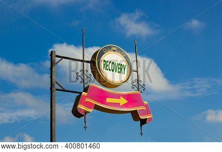 Recovery Symbol. Street Sign With Word 'recovery' And Arrow On Metal Pole. Blue Sky Background. Char