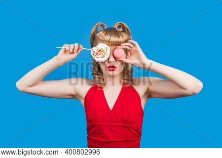 Pin Up Girl With Lollipop On Stick Isolated On Blue Background. Sweetness. Smiling Woman With Colorf